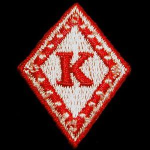 KAP 1 1/4″T Diamond Emblem W/Heat Seal Backing